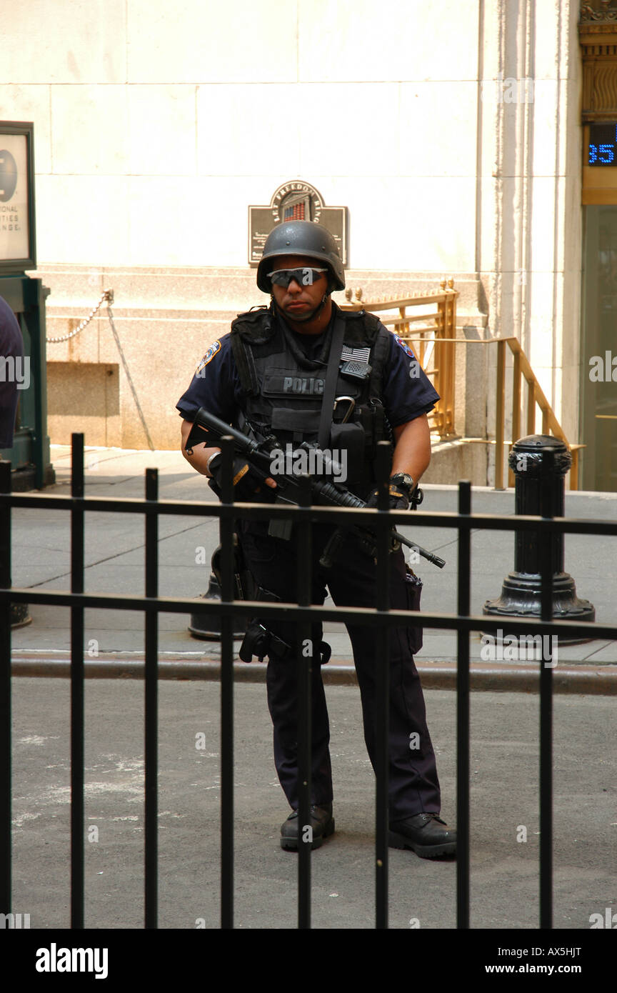 Armed soldier in front of Wall Street New York USA Stock Photo