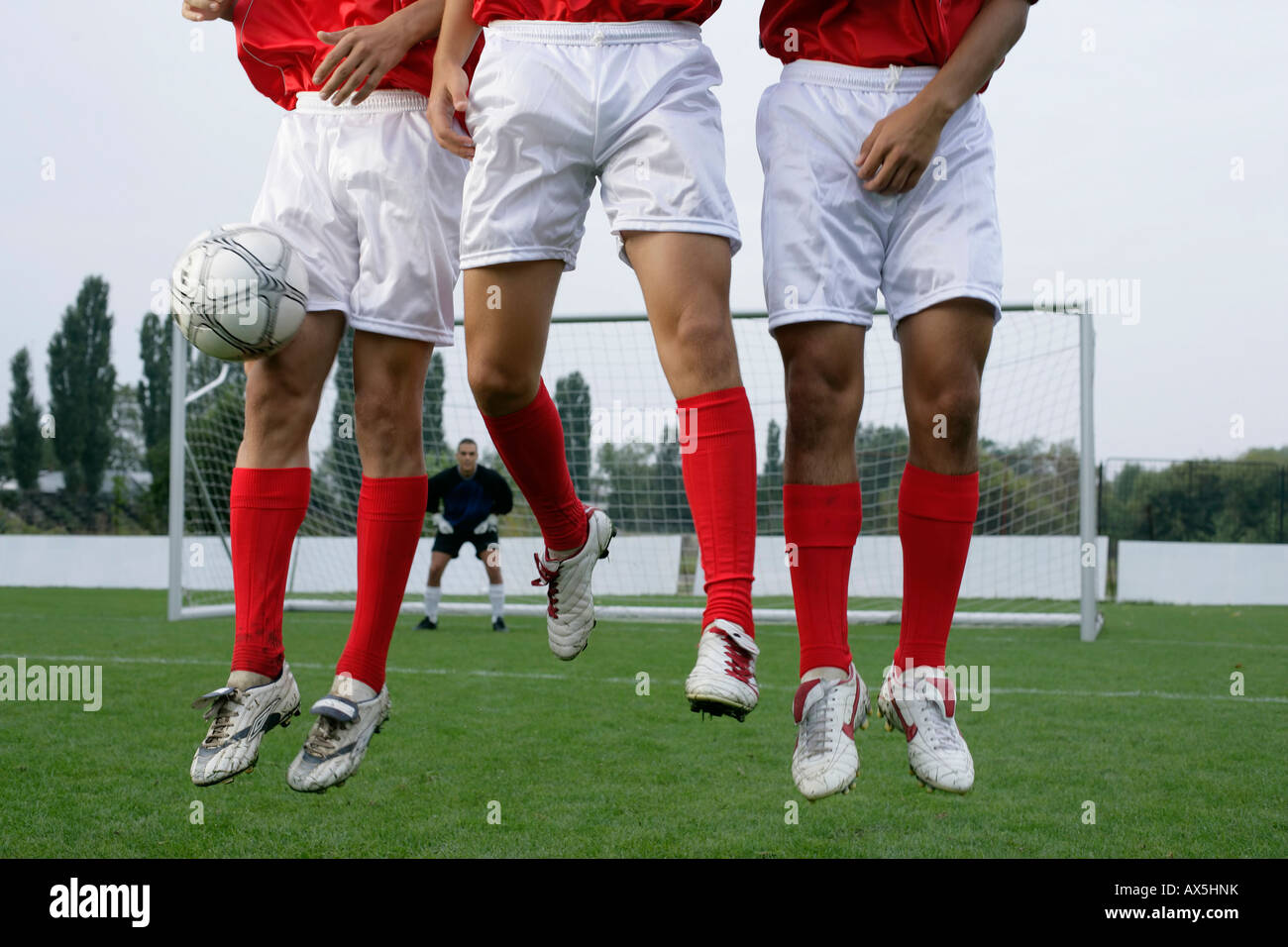 Soccer players forming a wall - Stock Image
