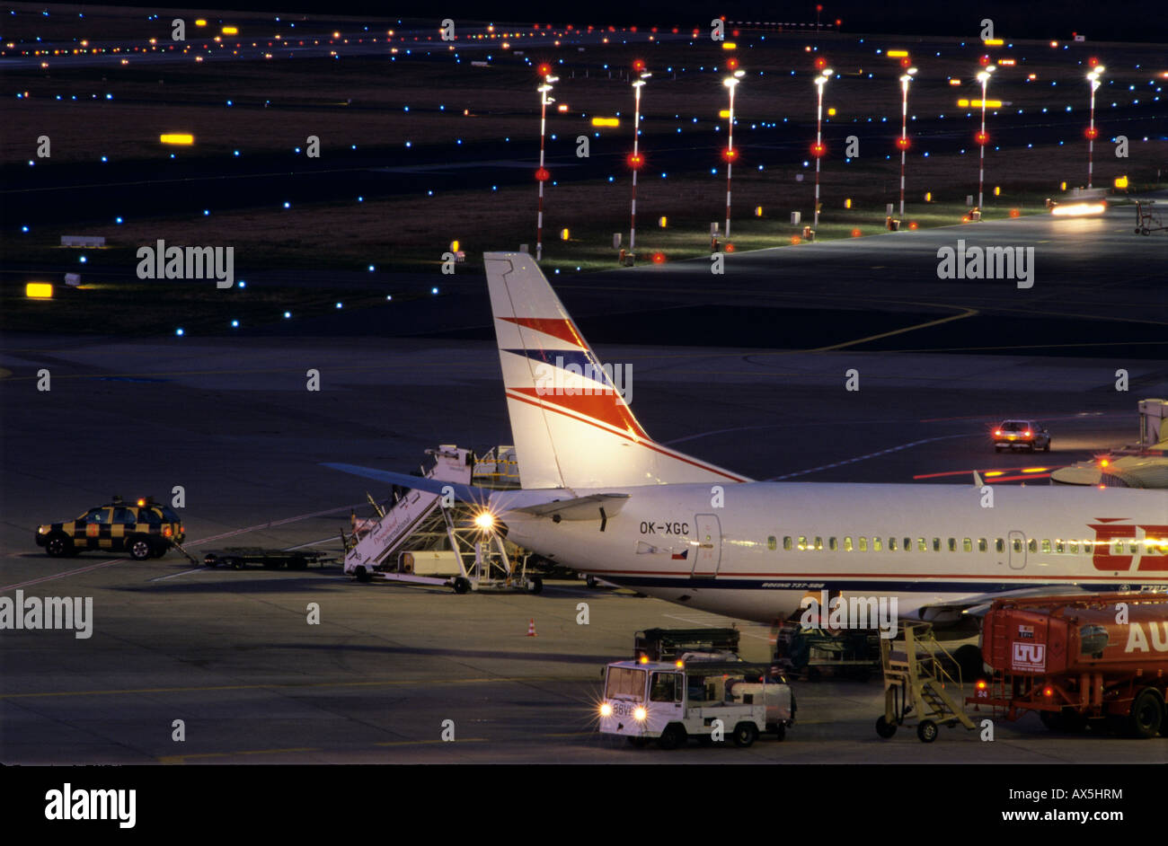 Airplane being repaired overnight - Stock Image