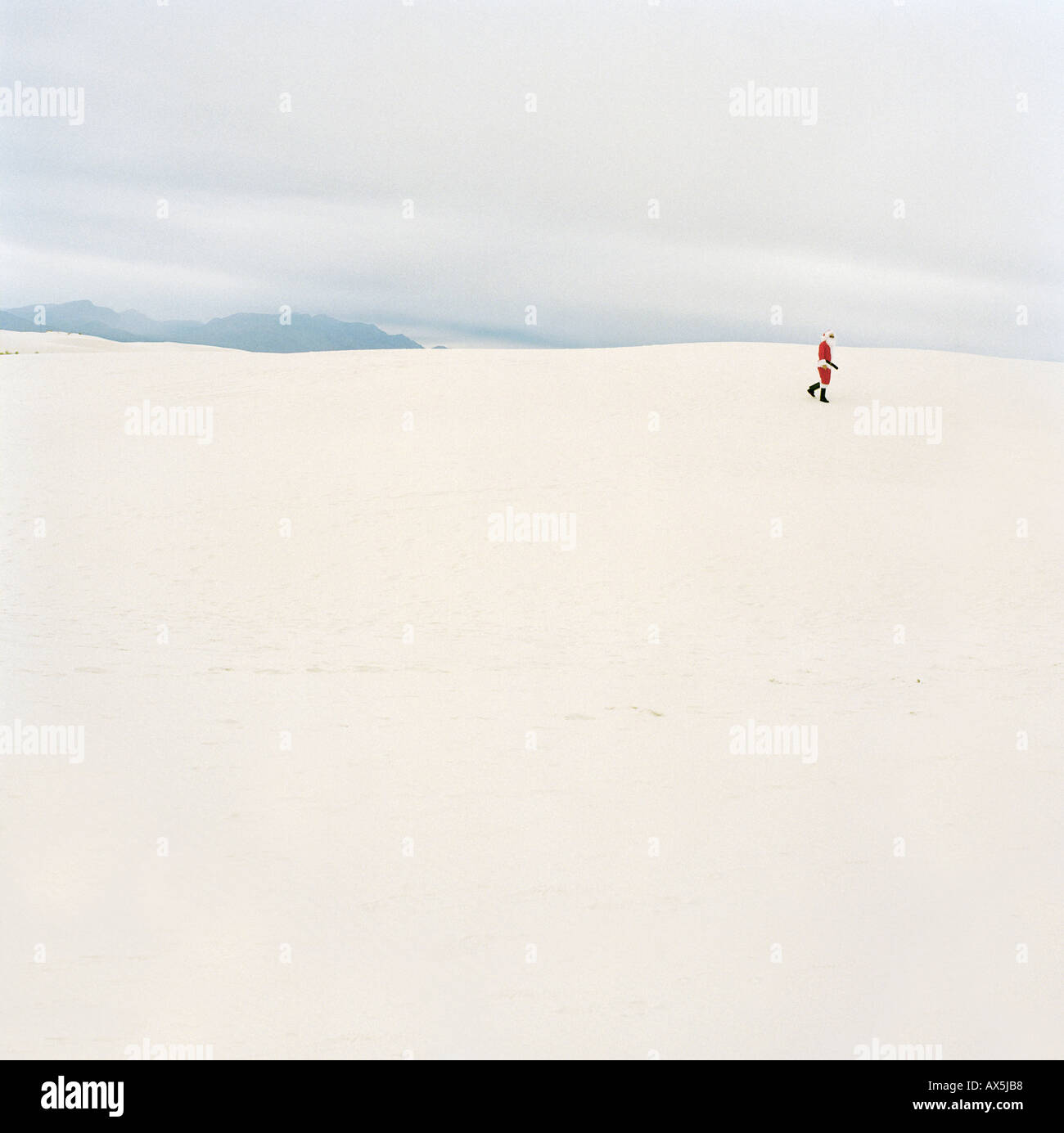 Santa Claus walking in the desert New Mexico USA - Stock Image