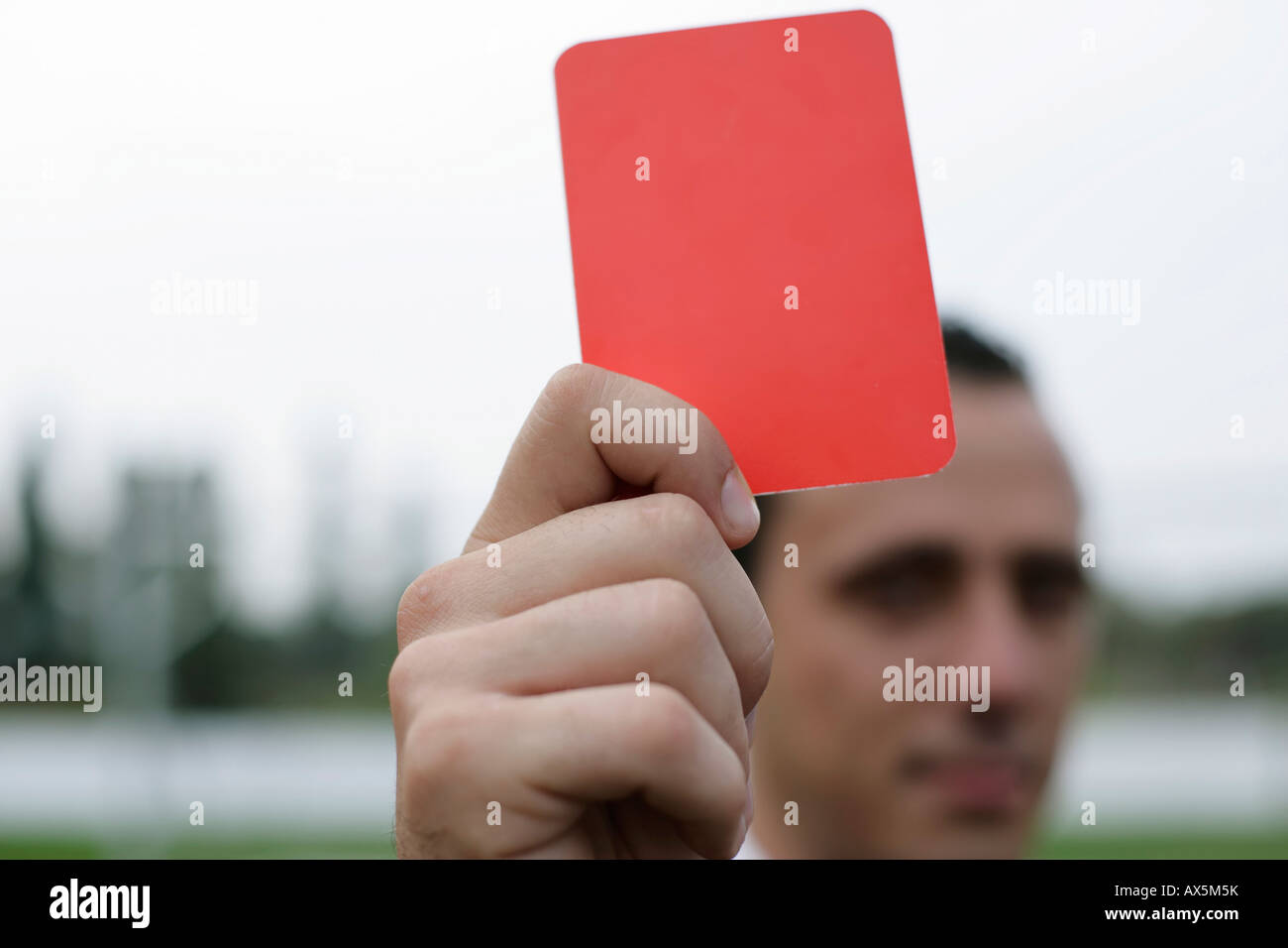Referee showing the red card - Stock Image