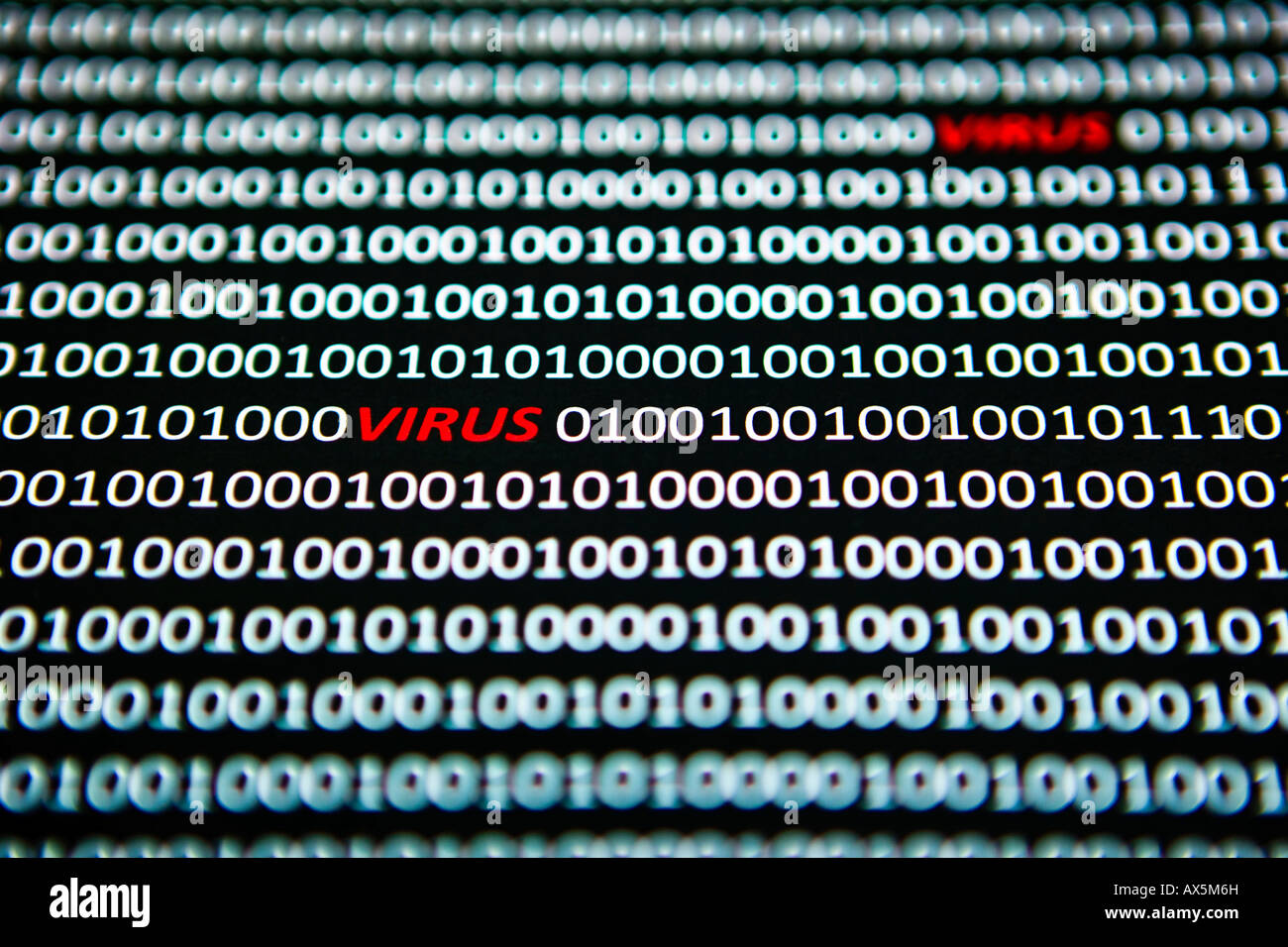 Computer virus, 'virus' spelled out in red between bit coding in a computer data stream - Stock Image