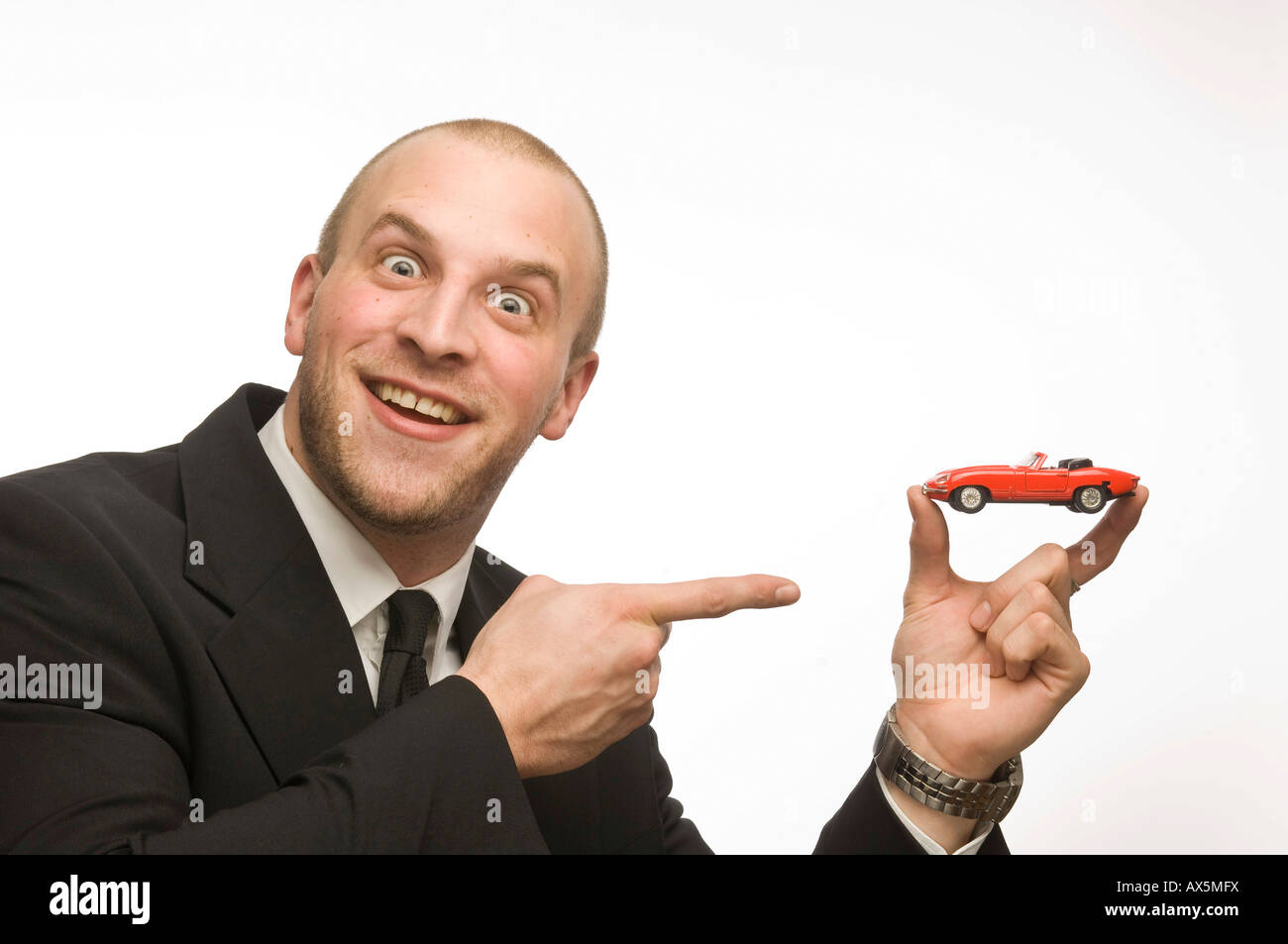 Young man holding model car Stock Photo