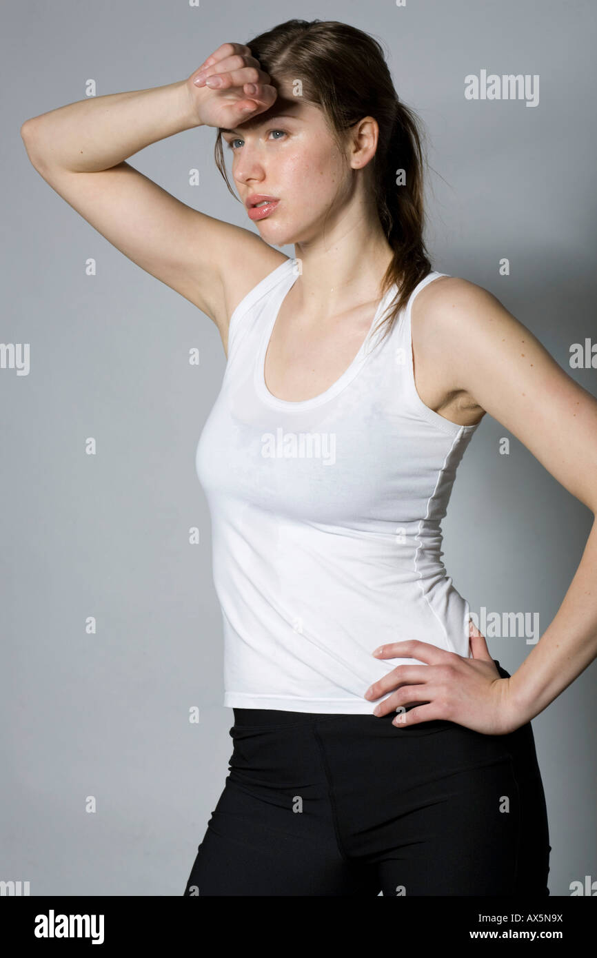 Young woman exhausted after a work-out - Stock Image