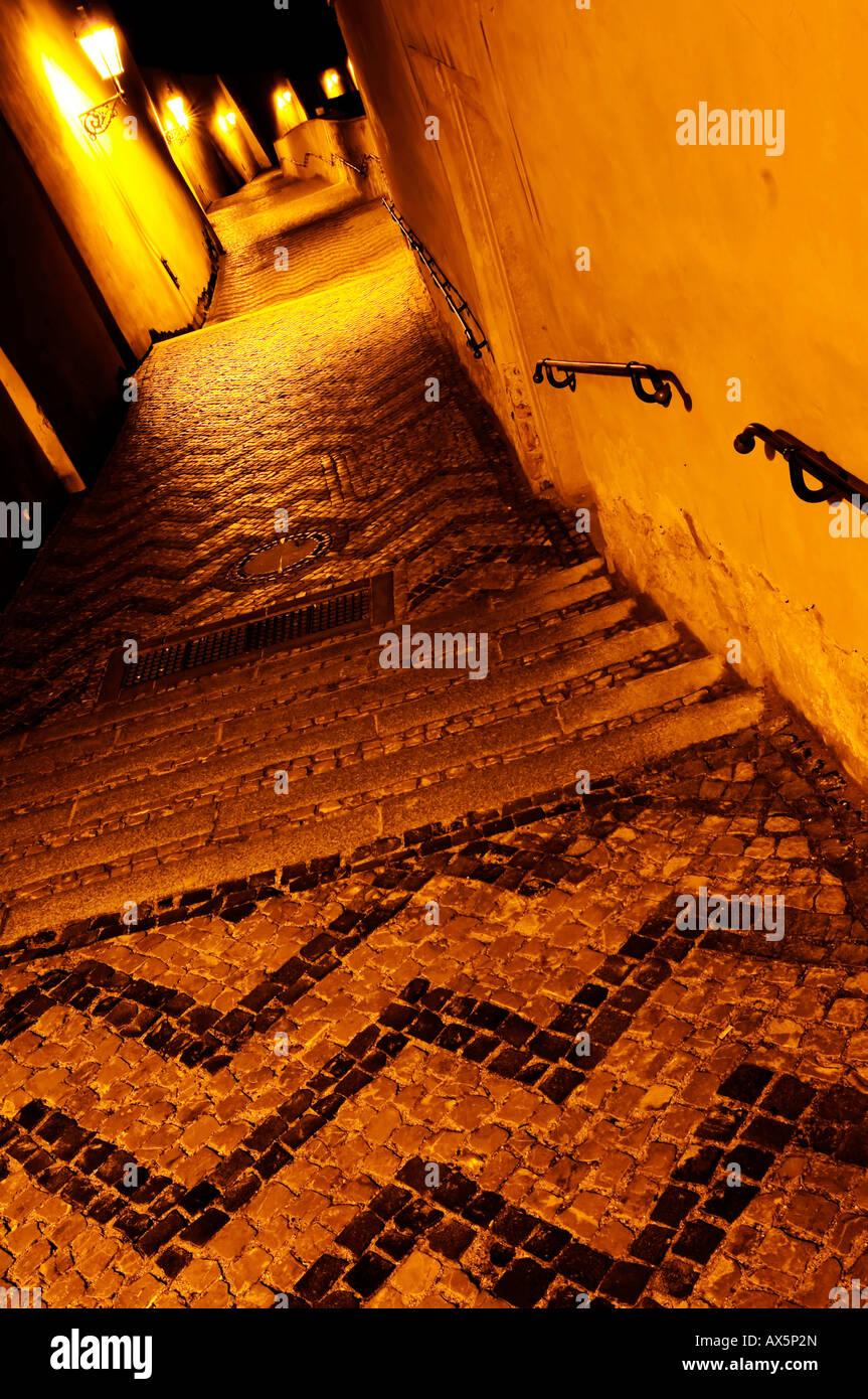 Narrow old alley at nighttime, Hradčany (Castle District), Prague, Czech Republic, Europe - Stock Image