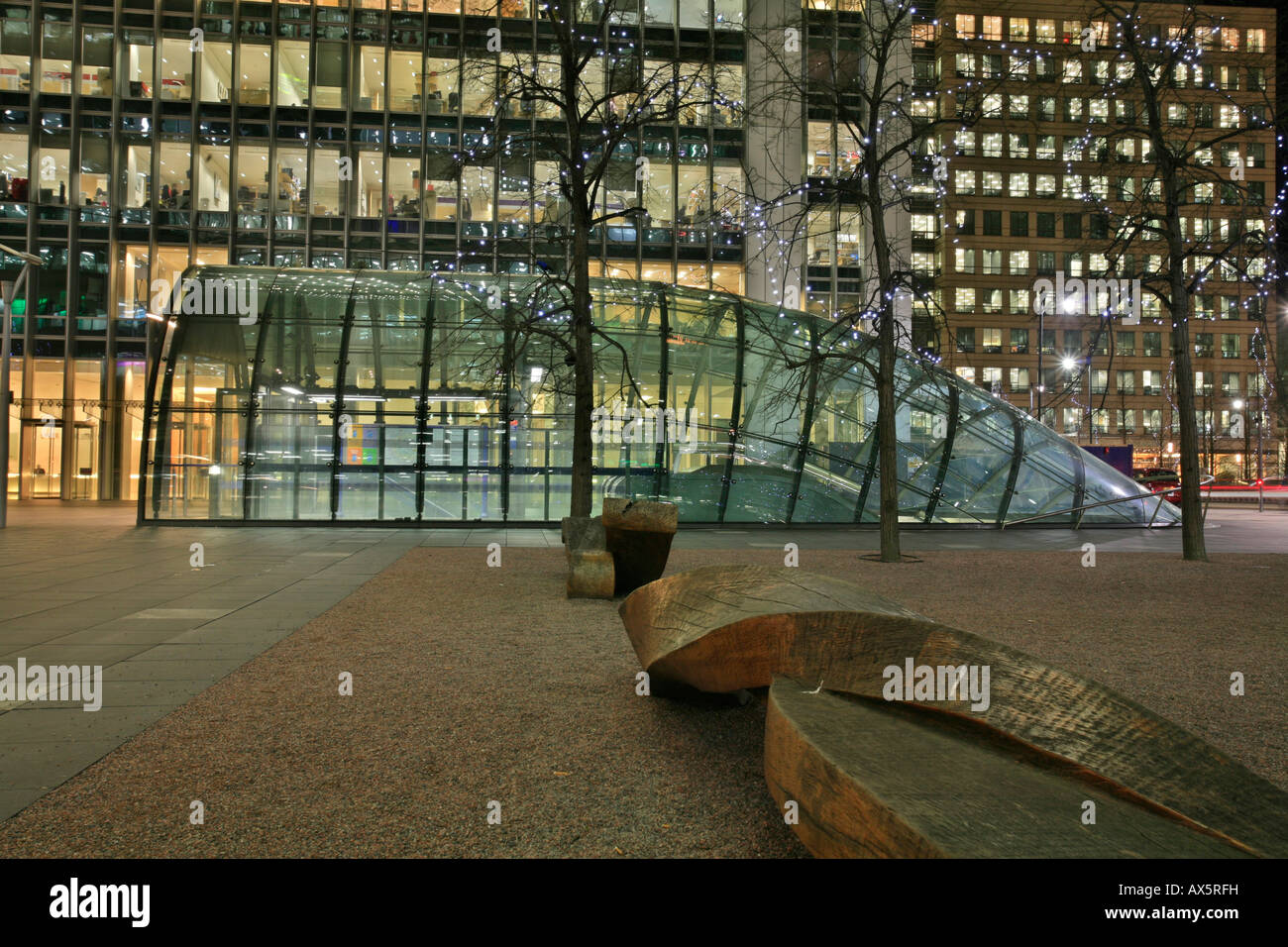 Canary Wharf and Canada Square, bench sculpture, entrance to underground station and skyscrapers, Docklands, London, - Stock Image