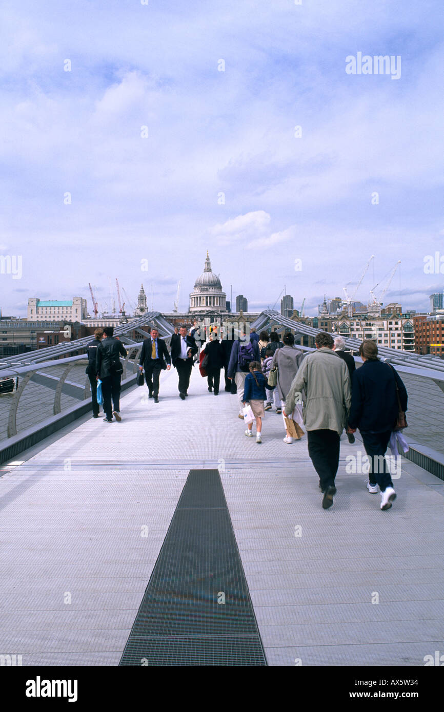 new millennium walking Bridge over the Thames River in London England - Stock Image