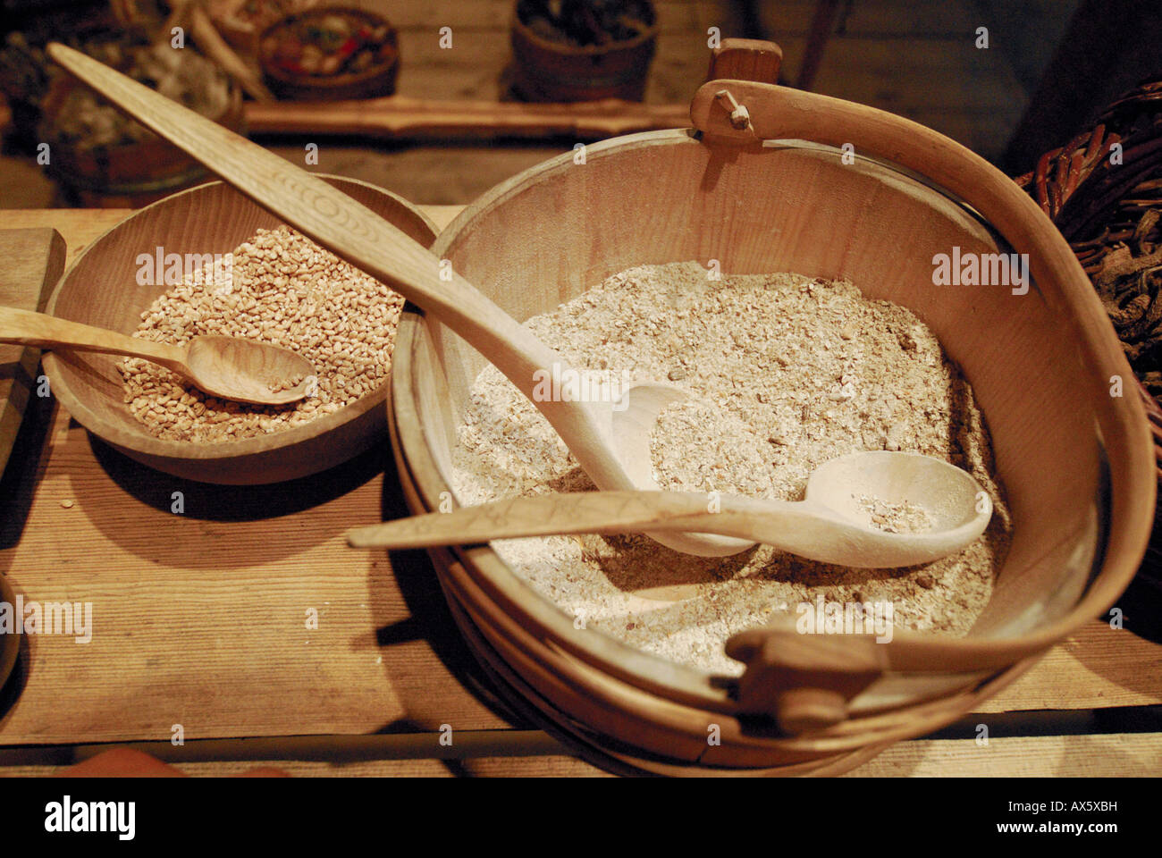 Wooden bowl filled with cereal, exhibit at Bostad Borg Viking Museum, Lofoten, Norway, Europe Stock Photo