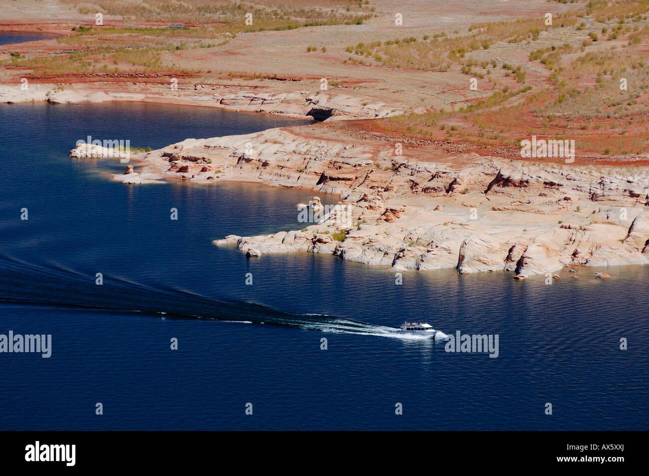 Motorized yacht navigating Lake Powell, Arizona, USA, North America - Stock Image