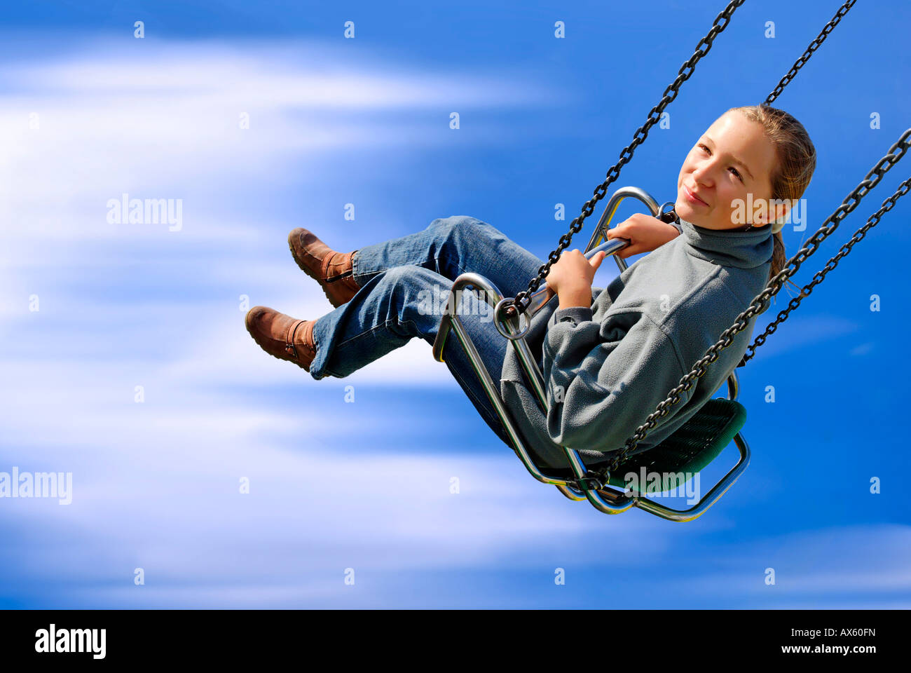 Girl on a swing carousel Stock Photo