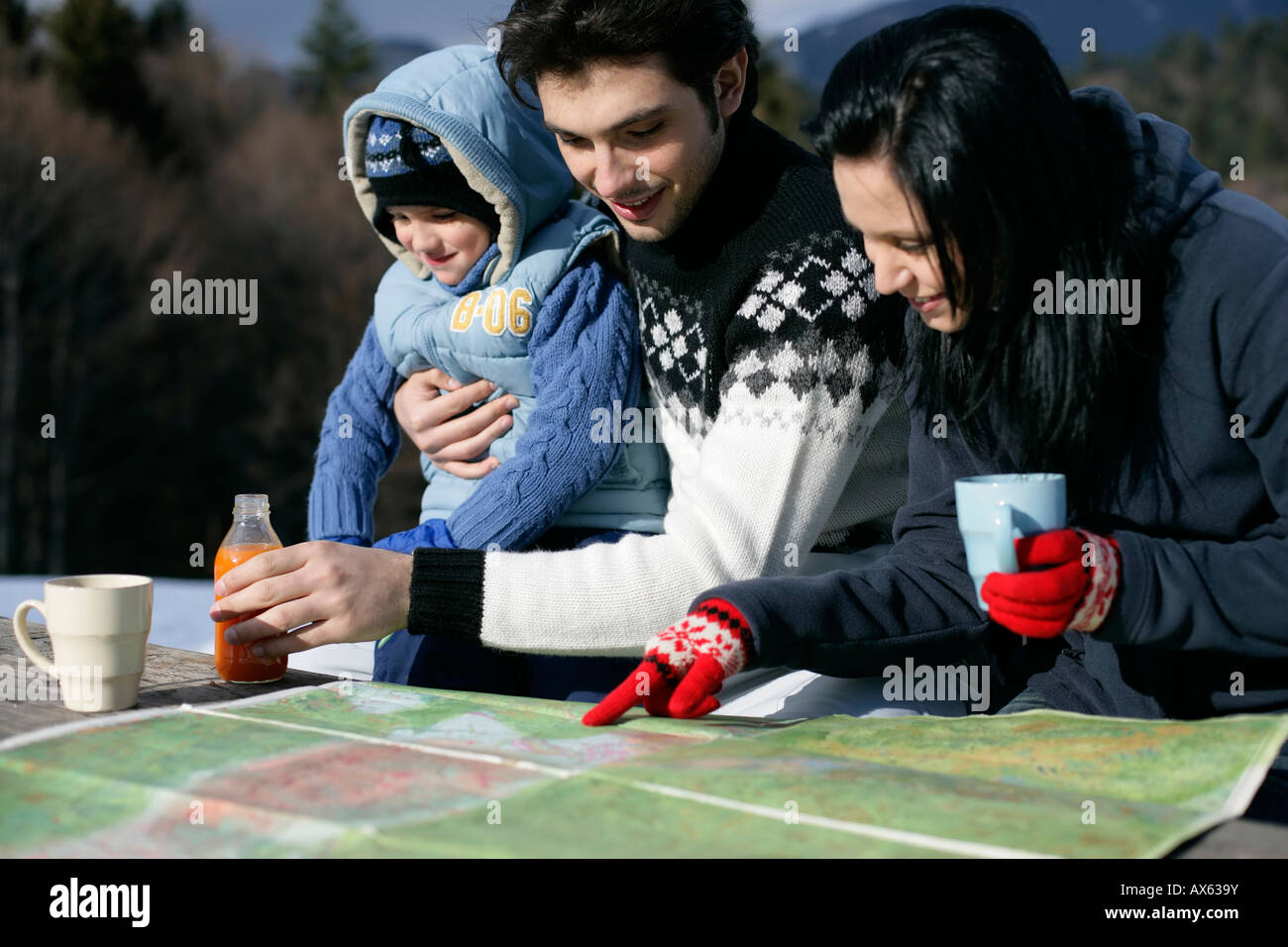Family looking at a map - Stock Image