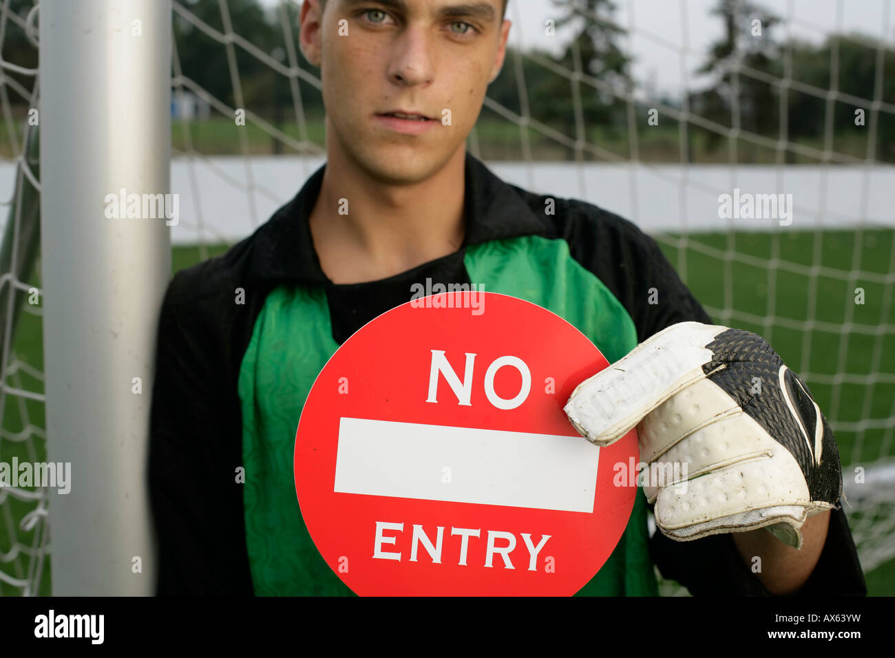 Goalkeeper showing label 'no entry' at camera - Stock Image