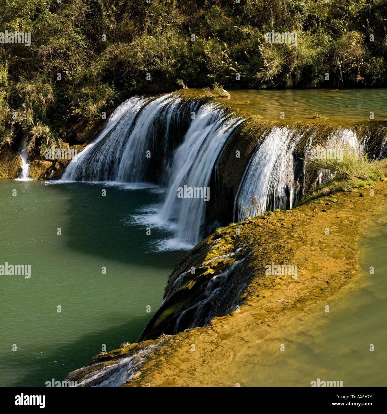 Upper cascades of Jiulong (Nine Dragons) waterfall Yunnan, China - Stock Image