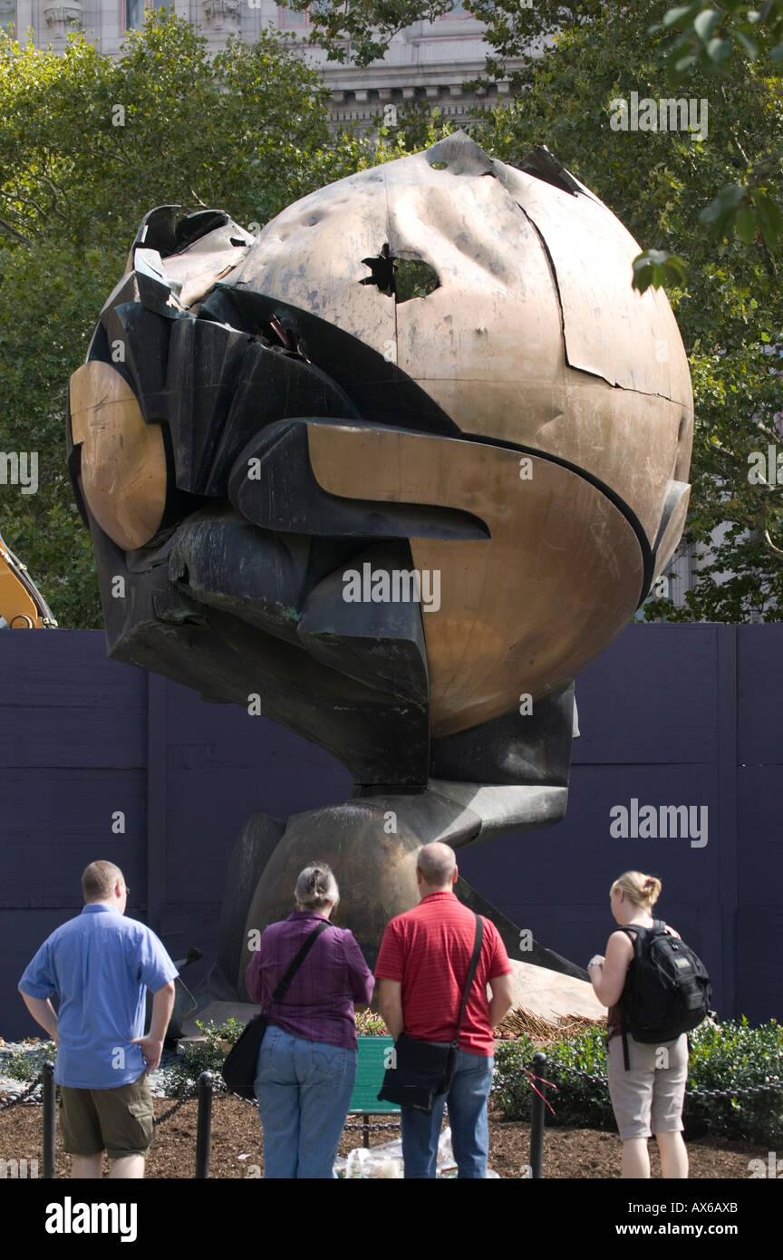The Sphere sculpture by artist Fritz Koenig damaged on 911 displayed at Battery Park New York City - Stock Image