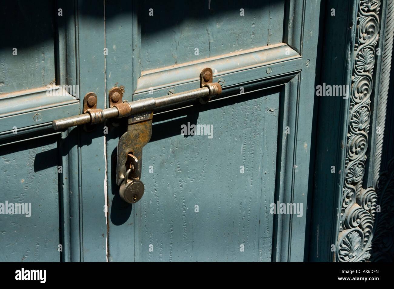 Locked Door and Carved Wooden Doorframe in Mattancherry Cochin India - Stock Image