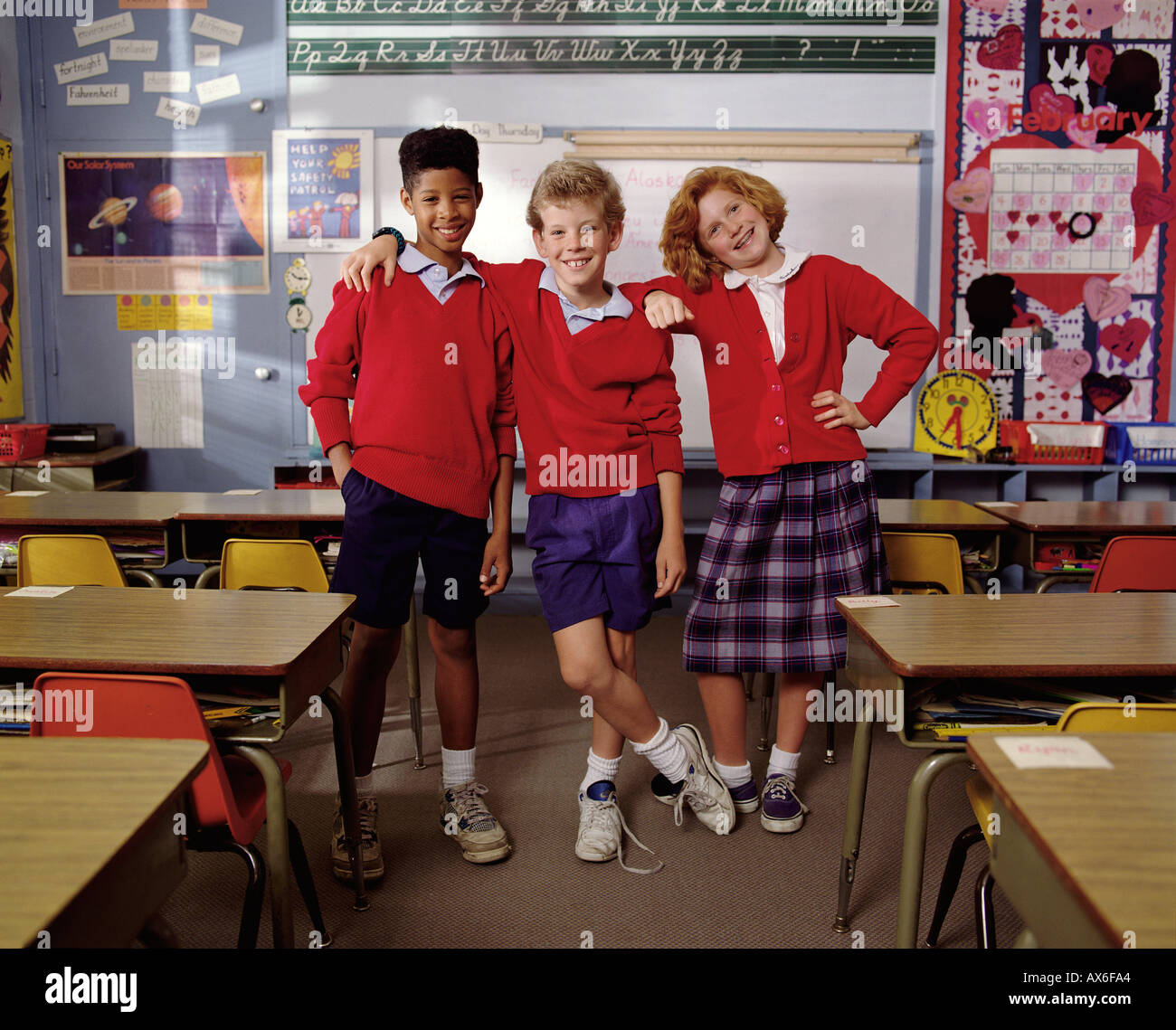 Three young elementary schoolchildren wearing private school