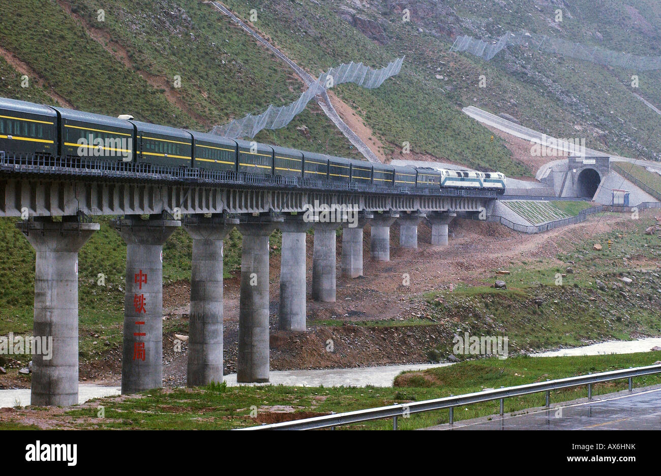 A train passes over a bridge on the Tibet railway, which opened in July 2006. - Stock Image