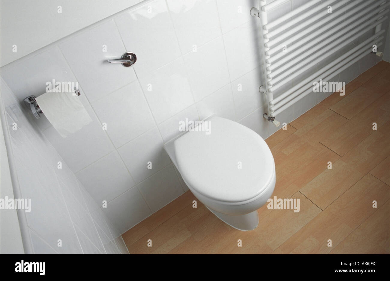 Radiator Voor Toilet : White toilet and towel radiator stock photo  alamy