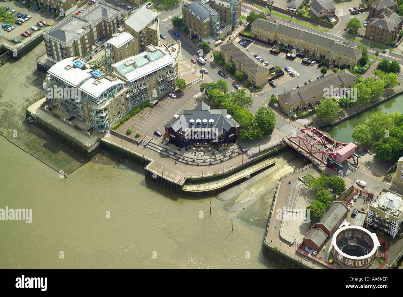 Aerial view of the Spice Island pub on the banks of the River Thames in the Rotherhithe area of London Stock Photo