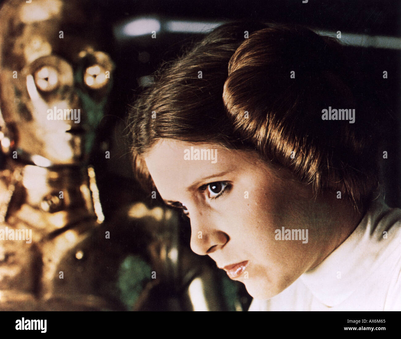 1977 TCF/Lucas film starring Carrie Fisher as Princess Leia Organa here with See Threepio played by Anthony Daniels - Stock Image