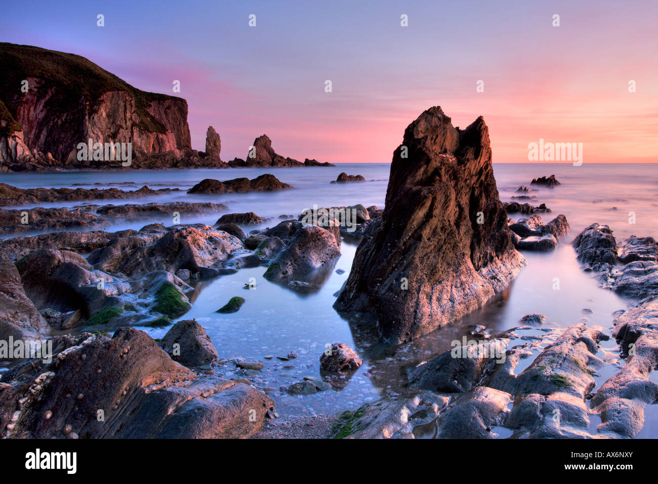 Jagged rocks and cliffs around Bantham in South Devon - Stock Image