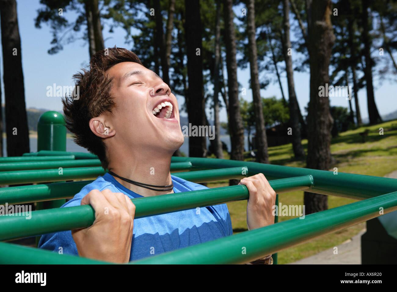 Young man on monkey bars - Stock Image