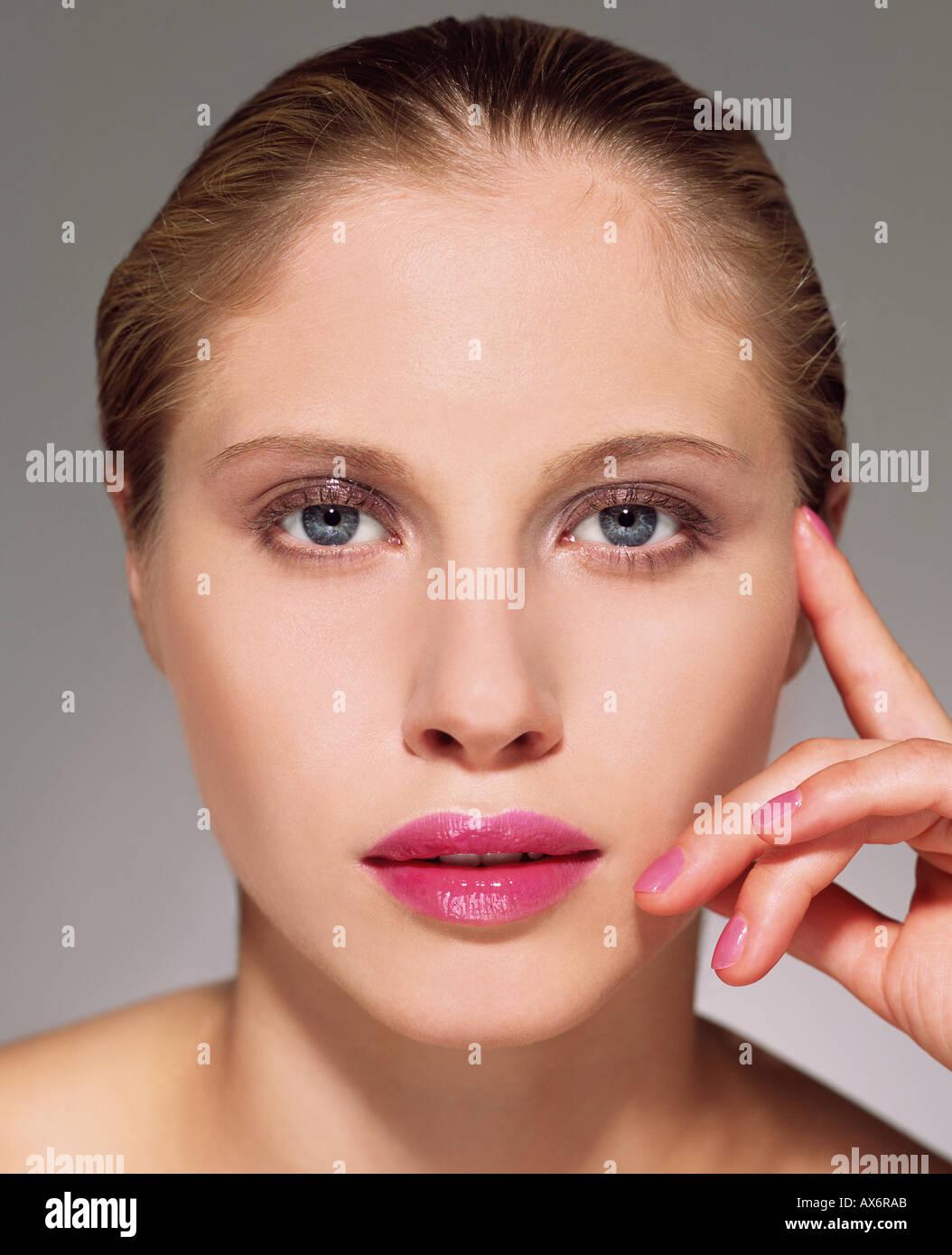 Woman wearing pink lipstick - Stock Image