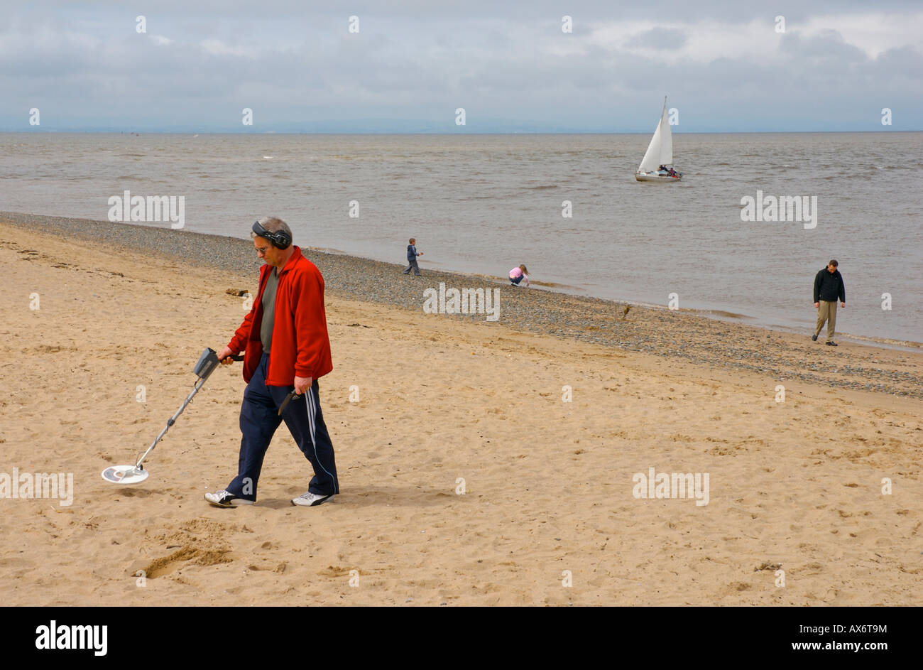 Jew Detector: Man With Metal Detector, Treasure Hunting On The Beach At