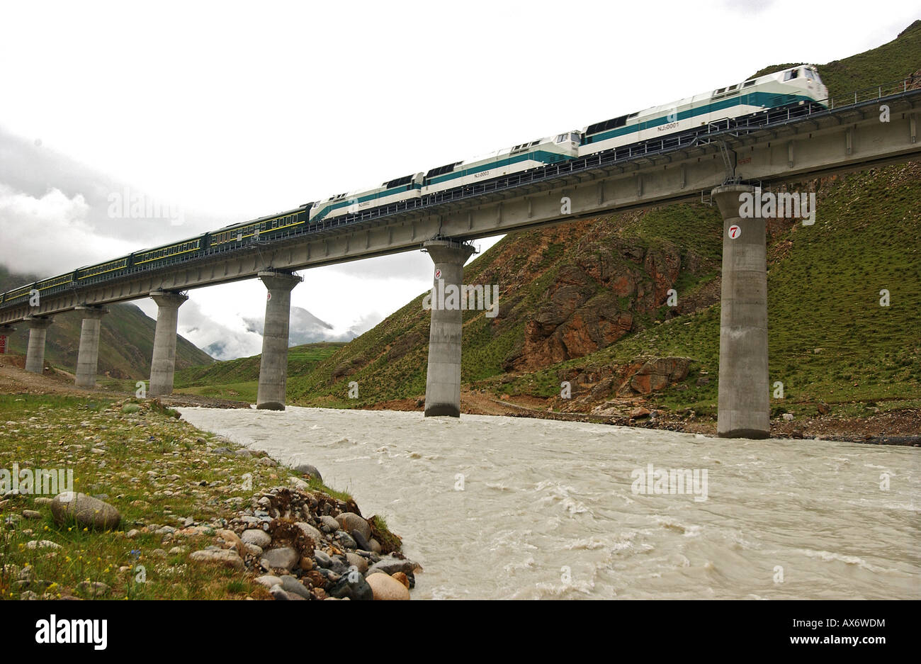 A train passes over a bridge non the Tibet railway in the Tolung Valley, which opened in July 2006. Tibet train Stock Photo