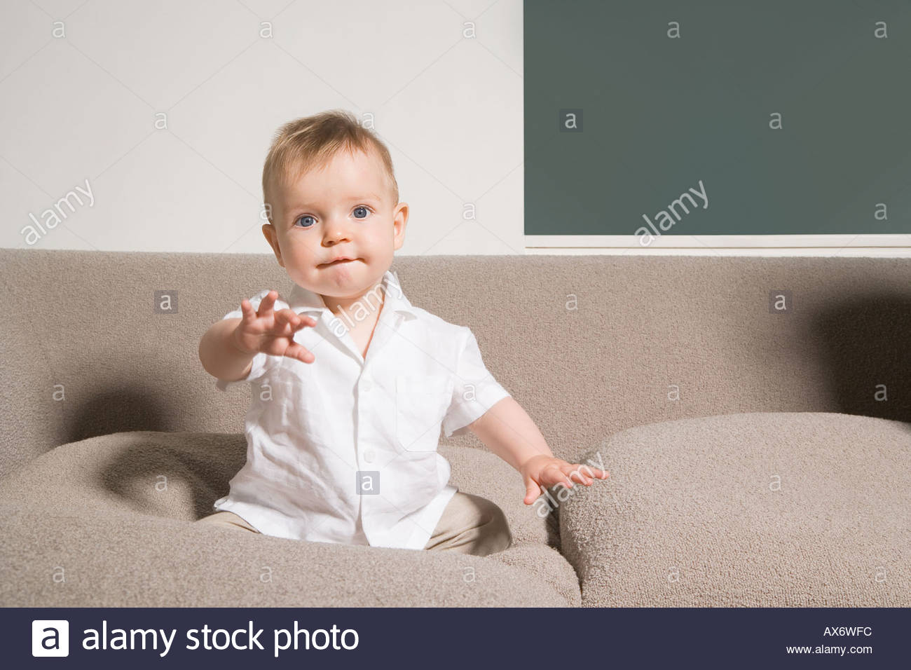 Baby on sofa - Stock Image