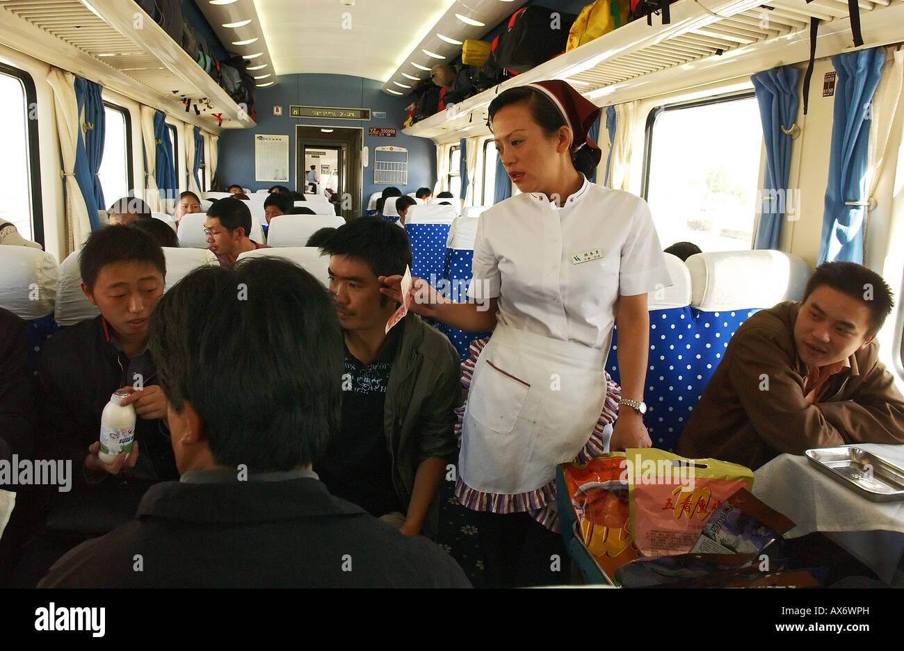 Passengers buy food on board the Tibet train, Tibet railway - Stock Image