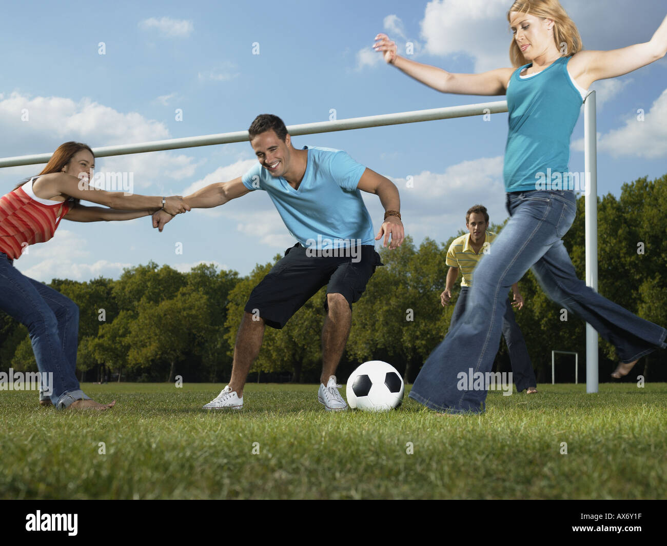 Friends playing football in the park Stock Photo: 5468958 ...