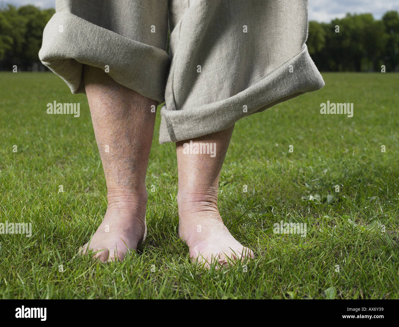 Bare foot woman in the park - Stock Image