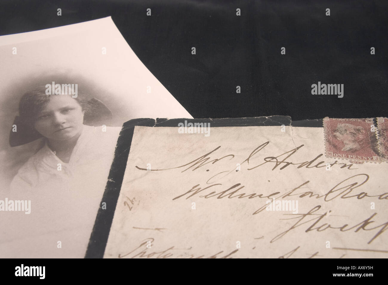 Black edged victorian letter announcing death with accompanying black and white photo - Stock Image