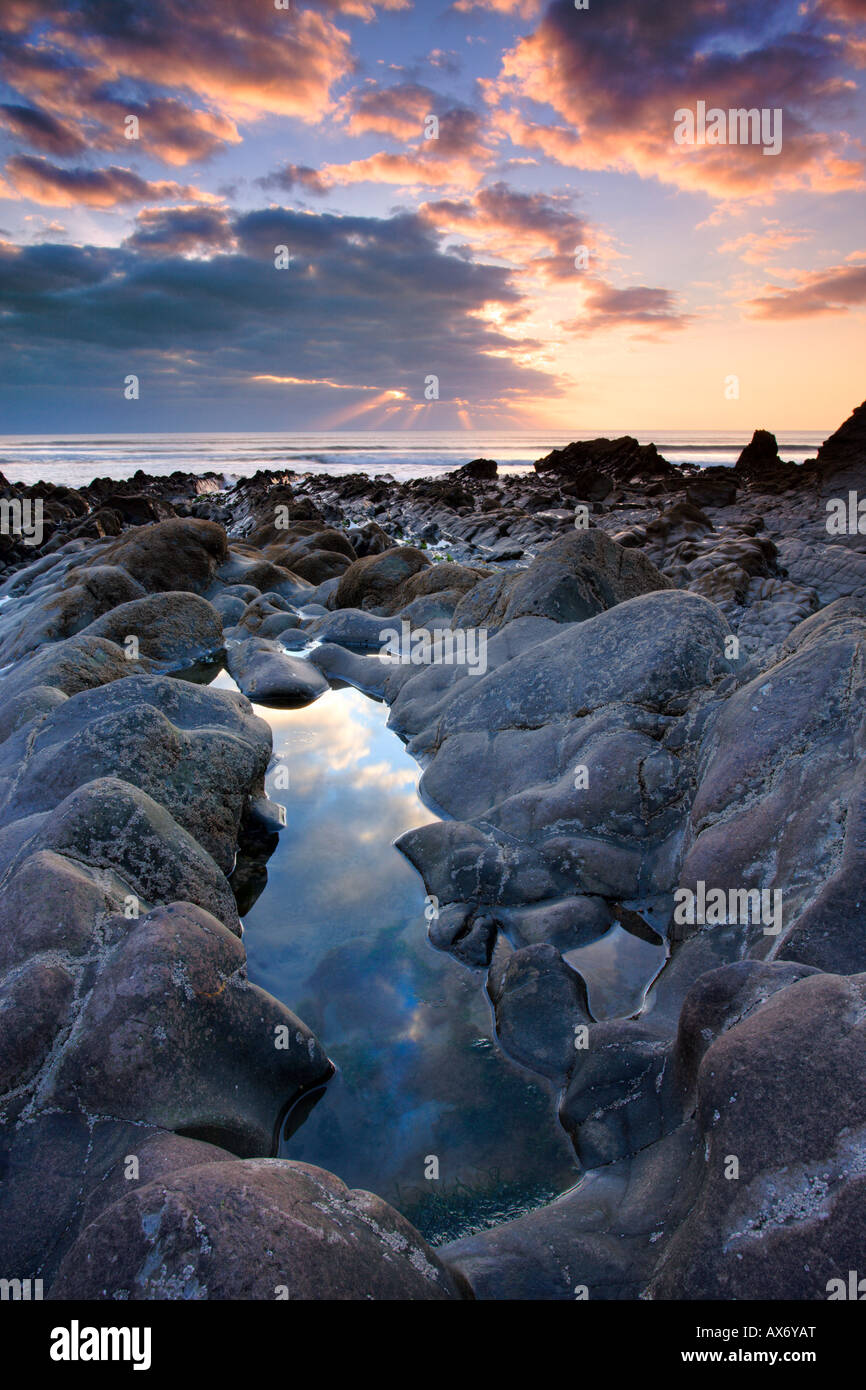 Rockpool and sunset at Sandymouth, North Cornwall - Stock Image