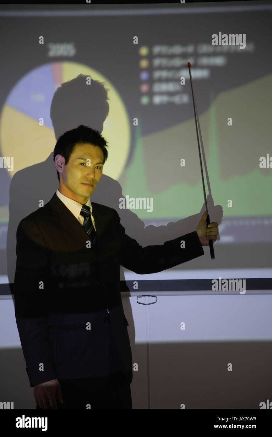 Businessman with a graphical representation - Stock Image