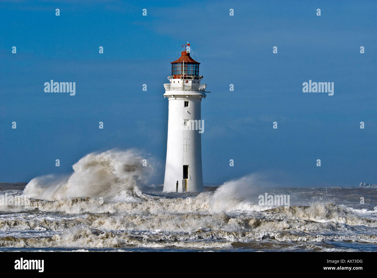 Perch Rock lighthouse New Brighton storm pic in the waves - Stock Image