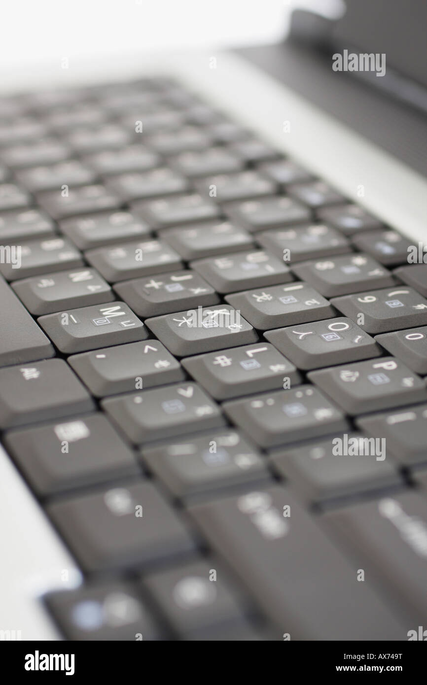 Close Up Of Laptop Keyboard With English And Chinese Characters On