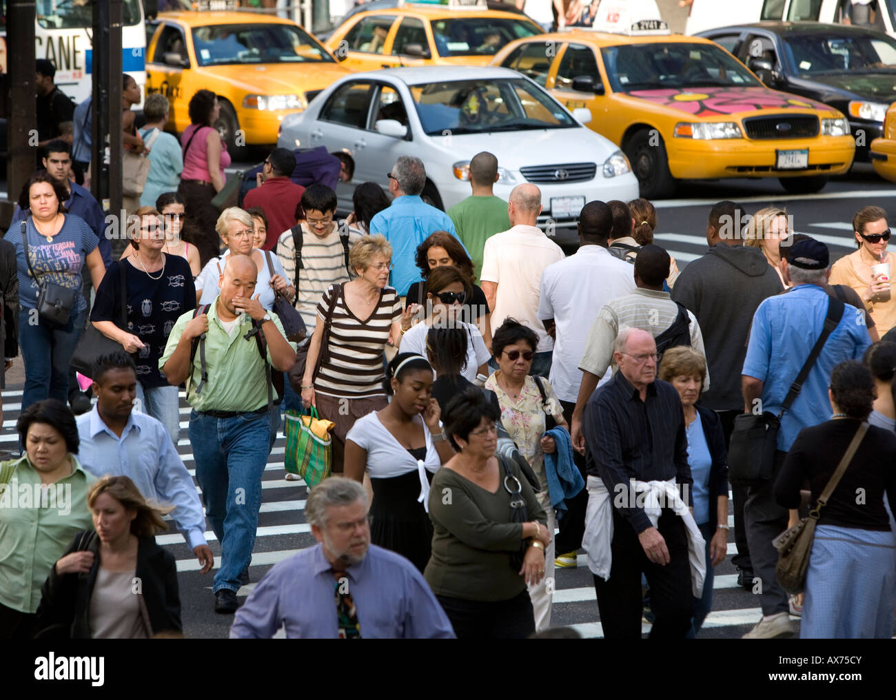 42nd Street and Fifth Avenue is constantly clogged with pedestrians in New York City. - Stock Image