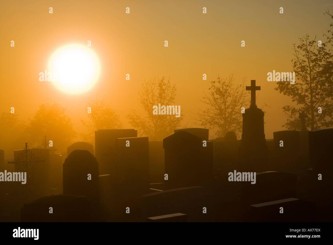 Germany, Bavaria, Hohenpeißenberg, Grave yard at dawn - Stock Image