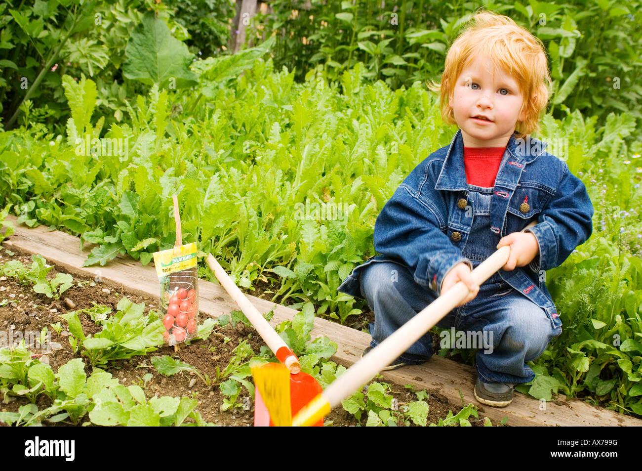 Boy (7-8) in the garden, portrait Stock Photo