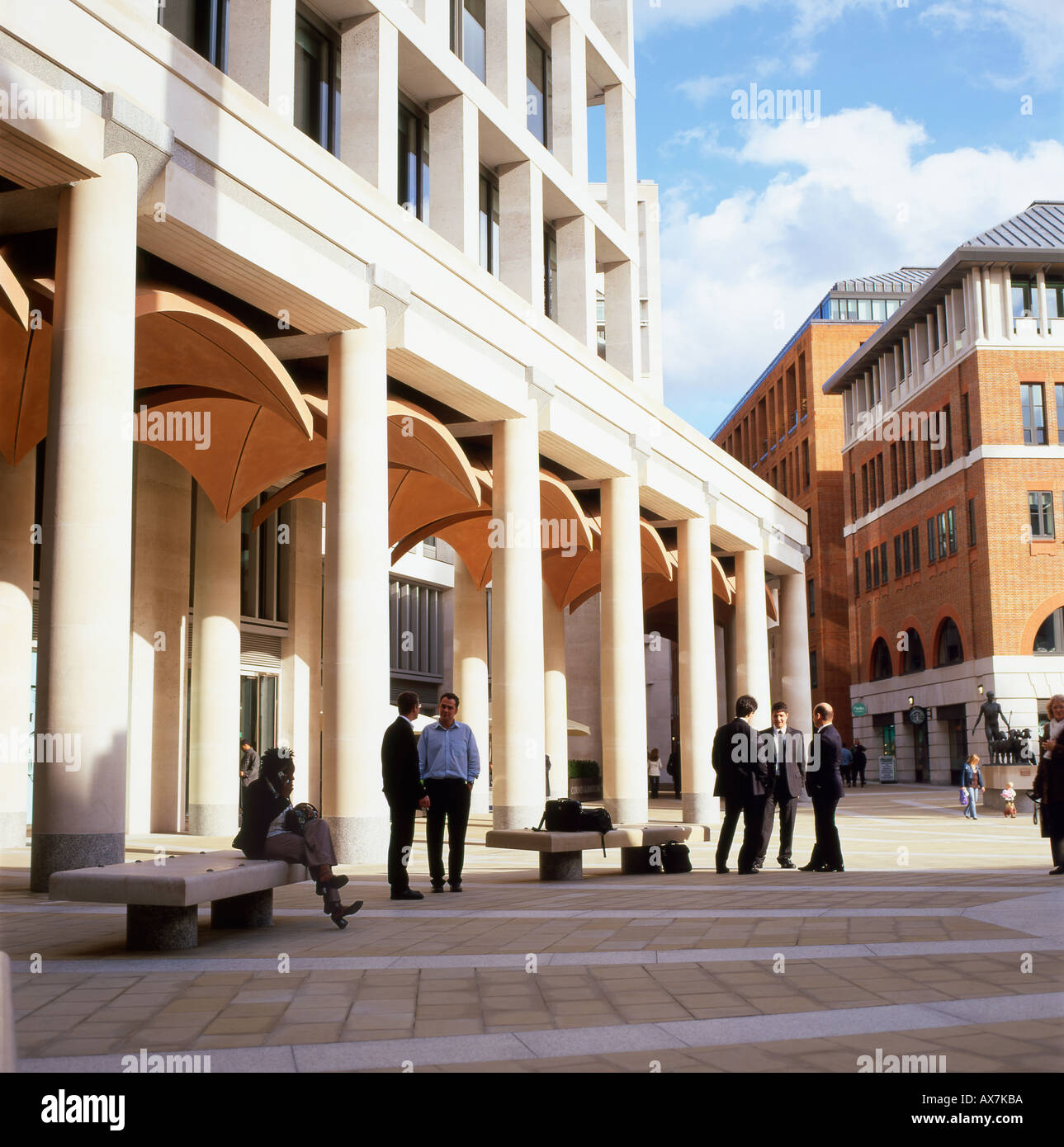 Businessmen standing talking outside the London Stock Market building in Paternoster Square in The City of London England UK - Stock Image