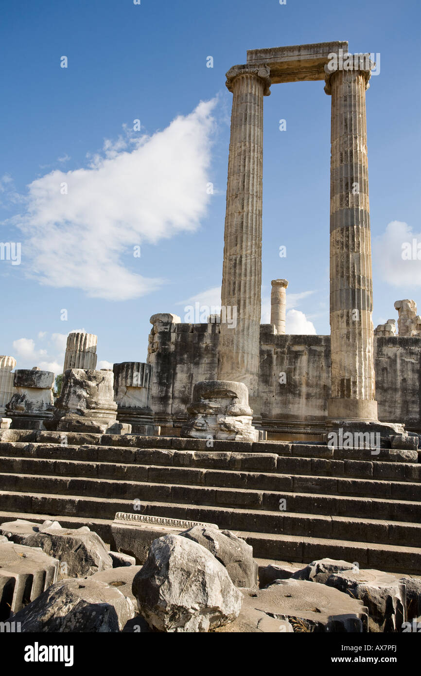 Arch Step and Cloud Stumps of columns frame a view of massive columns at the temple at the ancient Greek ruins of - Stock Image