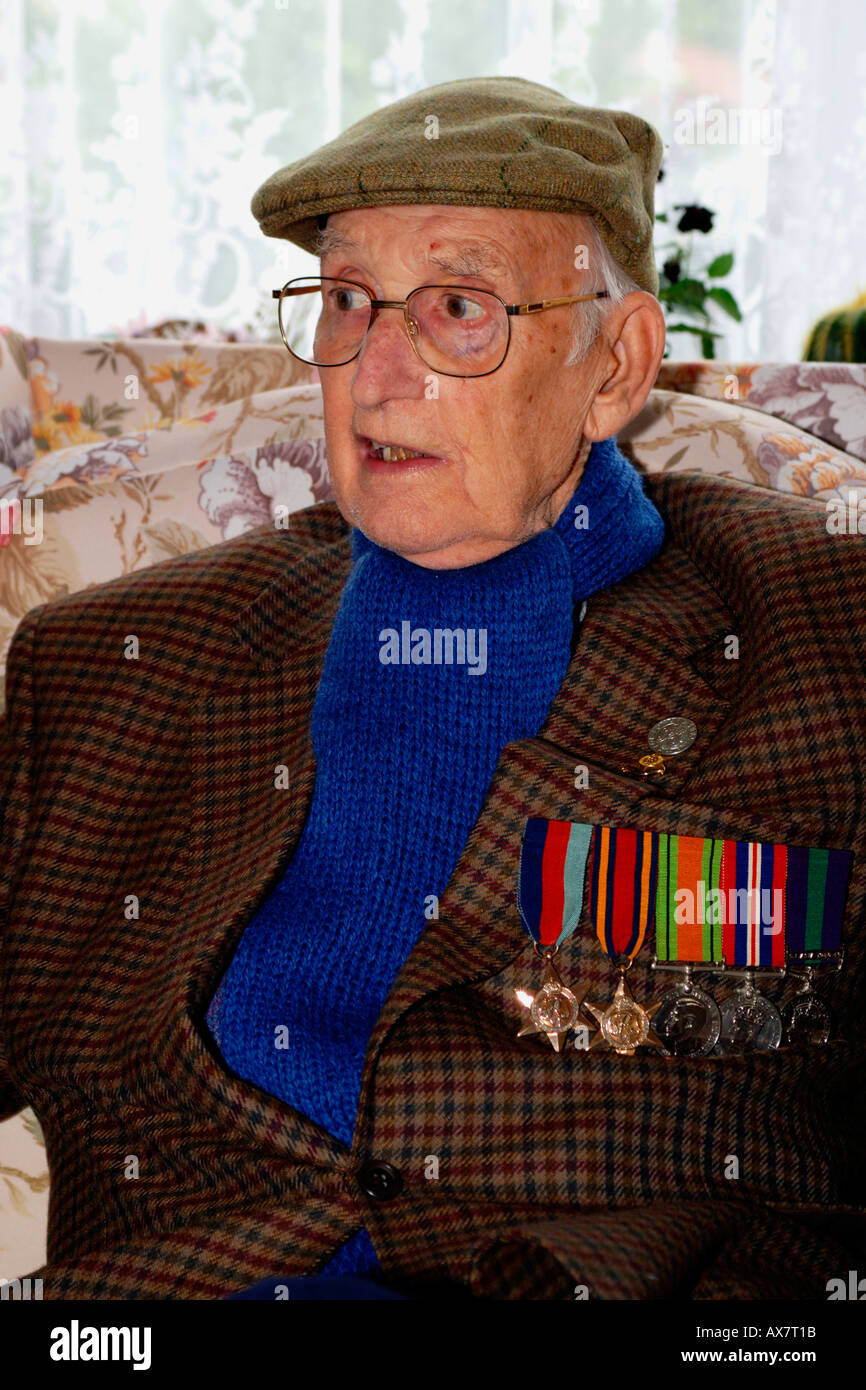British War Veteran wearing his medals on Remembrance day. - Stock Image