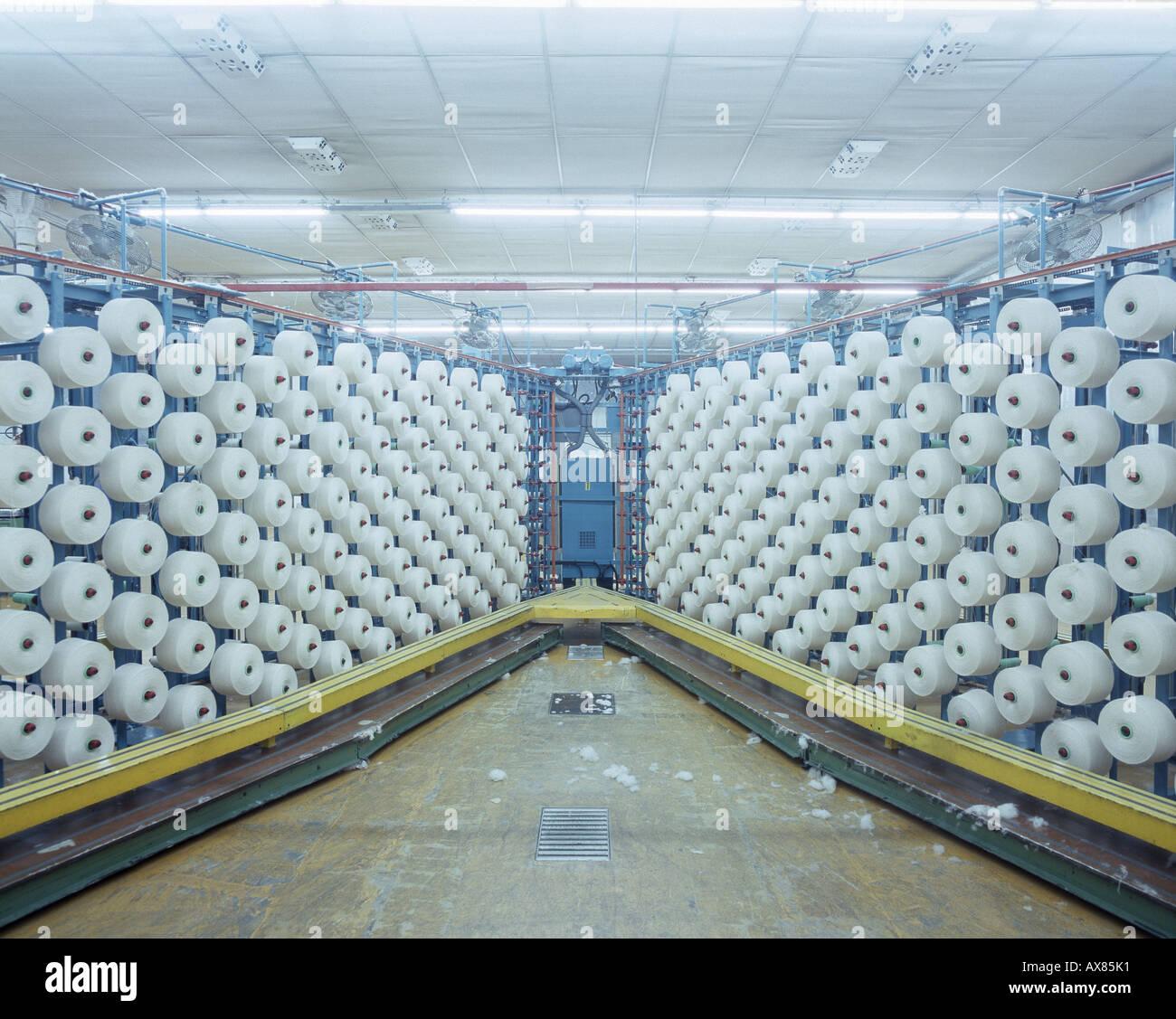 Cotton Yarnrolls, plying yarn, textile factory producing cotton fabrics, Legler S.p.A., Capriate near Bergamo, Italy - Stock Image