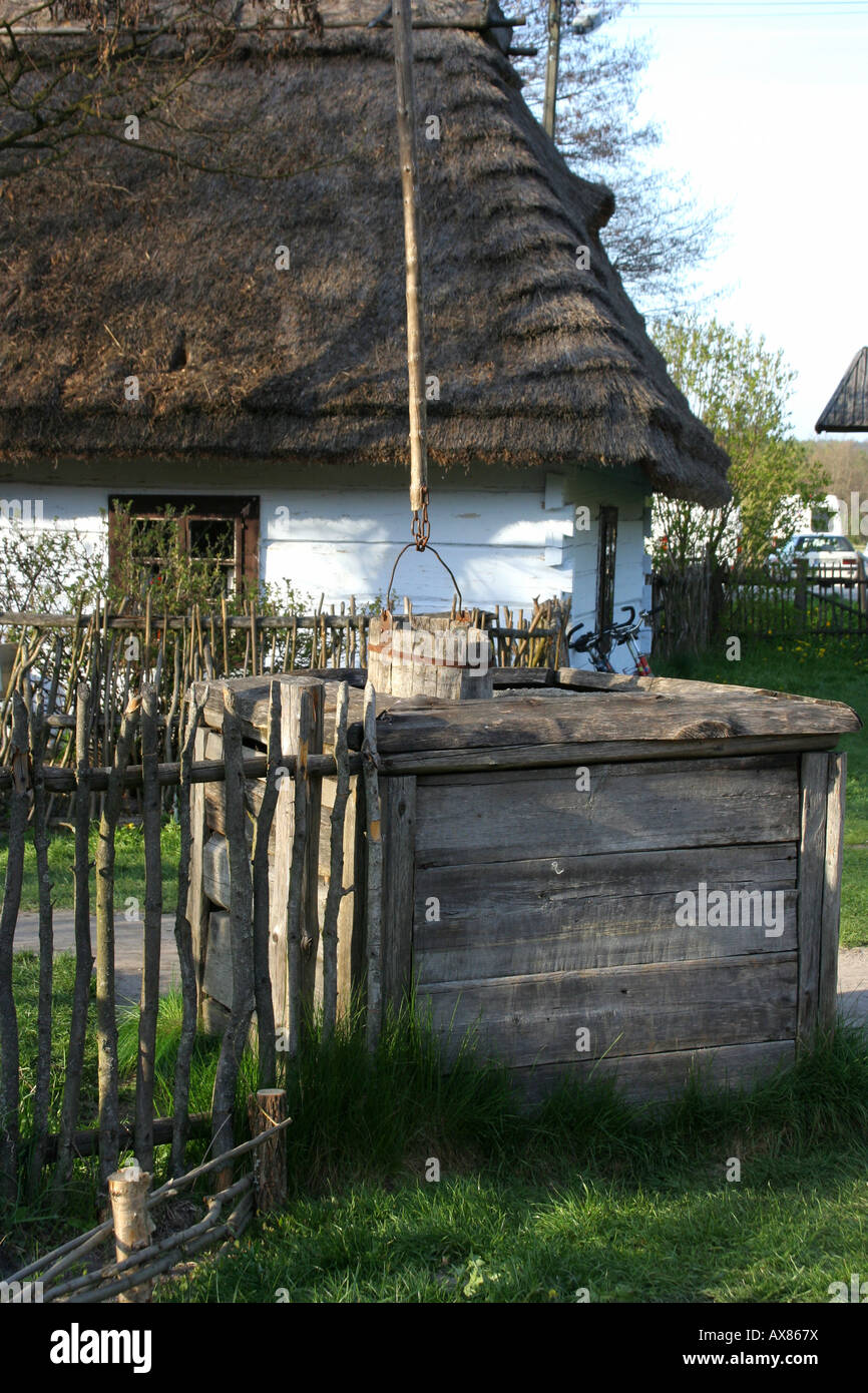 Crane well in Zagroda Guciow farm open air folk museum in Roztocze region Poland Stock Photo