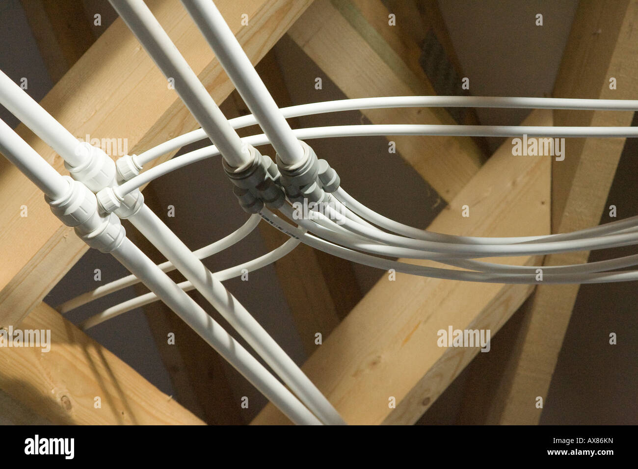 Speedfit polyethylene central heating water pipes in the loft in a ...