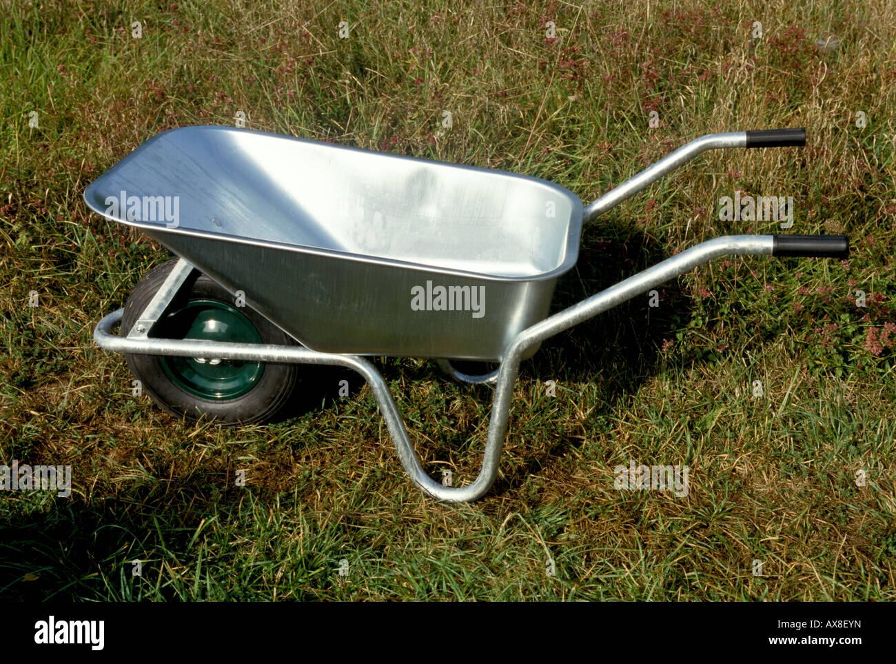 a new galvanized wheelbarrow - Stock Image
