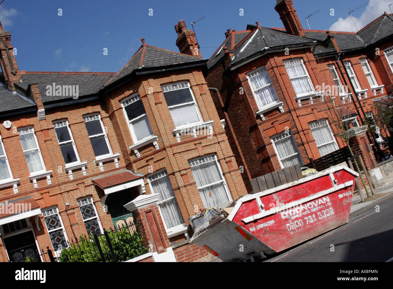 Skip outside a house in Willesden Green, North West London - Stock Image