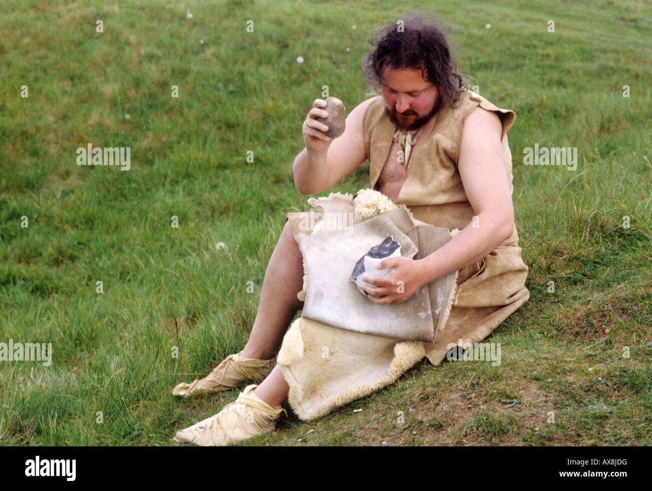 Flint Knapping re enactment Stone Age man Grimes graves Norfolk East Anglia England UK English prehistory prehistoric - Stock Image